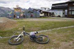 Mountain bike riders getting ready in Mottolino bikepark on 3 August 2016 in Livigno, Italy. Royalty Free Stock Photos