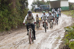 Mountain Bike riders in the rain in the Andes Royalty Free Stock Images