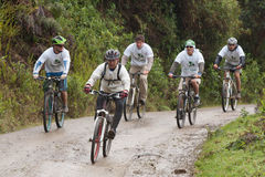 Mountain Bike riders in the rain in the Andes Stock Images