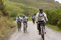 Mountain Bike riders in the rain in the Andes Stock Photos