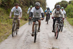 Mountain Bike riders in the rain in the Andes Stock Image