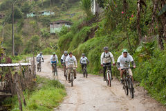 Mountain Bike riders in the rain in the Andes Royalty Free Stock Photography
