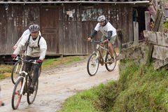 Mountain Bike riders in the rain in the Andes Stock Photography