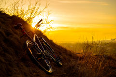 Mountain Bike on the Rocky Trail at Sunset. Extreme Sport Concept. Space for Text. Stock Photography