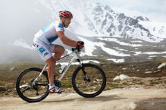 Mountain bike and runnig competiton Royalty Free Stock Photos