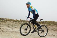 Mountain bike and runnig competiton Stock Photos