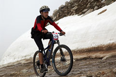 Mountain bike and runnig competiton royalty free stock photo