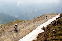 Mountain bike and runnig competiton Stock Image