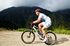 Mountain bike and runnig competiton Royalty Free Stock Image