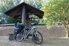 Mountain bike with saddlebags round the wooden arbour Royalty Free Stock Photography