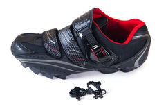 Mountain bike shoes and cleat. Isolated on white MTB cleat and shoes for mountain bike Royalty Free Stock Image
