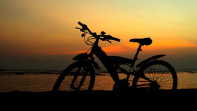 Mountain bike silhouette with sunset sky Royalty Free Stock Images