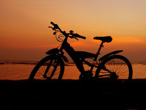 Mountain bike silhouette with sunset sky Stock Images