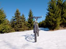 Mountain bike in snow.  Cycling on large tire wheels in fresh snow. Royalty Free Stock Photo