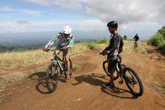 Mountain bike. Sports fans get ready to explore the mountain bike trail on the slopes Lawu, Karanganyar, Central Java, Indonesia Royalty Free Stock Images