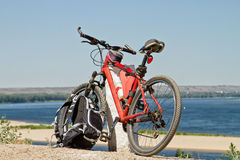 Mountain Bike stay on the background of river scenery Royalty Free Stock Photo