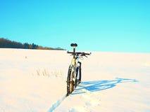Mountain bike stay in deep snowdrift. Rear wheel detail. Snow on tyre Royalty Free Stock Photo