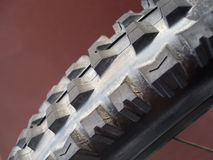 Mountain bike tire. Closeup of tread on tire of mountain bike, studio background Stock Image