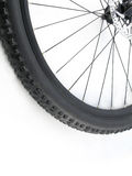 Mountain bike tire. Serie sport: Mountain bike tire isolated on white background (close-up royalty free stock image
