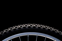 Mountain bike tire and rim on black Stock Photos