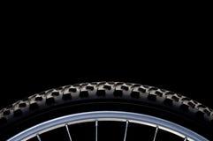 Mountain bike tire and rim on black stock photos