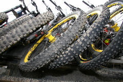 Mountain Bike Tires. A bunch of mountain bikes hanging out the back of a truck with all the treaded tires lined up Royalty Free Stock Photos