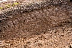 Mountain Bike Tracks in Mud Background Royalty Free Stock Photos