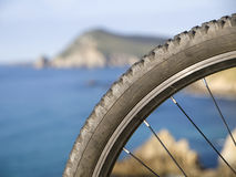 Mountain bike wheel with blurred landscape Stock Photo