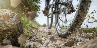 Free Mountain Bike Wheel On A Gravel Track Stock Image - 212689611