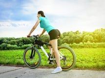 Mountain bike woman Stock Images