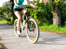 Mountain bike woman Stock Images