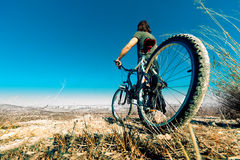 Mountain bike and young man Royalty Free Stock Image