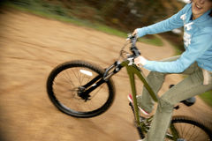Mountain bikeing. Cool girl rides a mountain bike stock photography