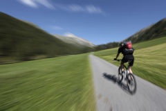 Mountain biker. On a cycle path in the South Tyrol, during a summer training Stock Image