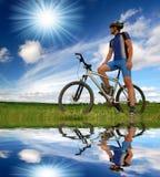Mountain biker. Biker relaxing on a mountain bike Stock Photography