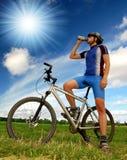 Mountain biker. Biker relaxing on a mountain bike Stock Photo