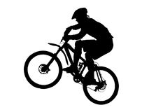 Mountain biker. Jump with a mountain bike (with vector eps format Royalty Free Stock Images