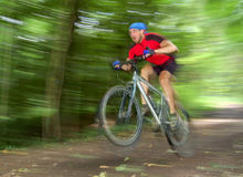 Mountain biker. Speeding cyclist on mountain bike Royalty Free Stock Photo