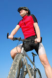 Mountain biker. Summer portrait of the cyclist on mountain bike Stock Images