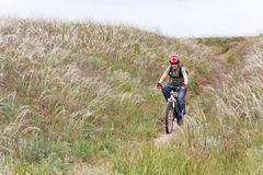 Mountain biker. Teenager on the mountain bike Royalty Free Stock Images