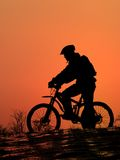 Mountain biker. Silhouette with beautiful orange sunrise Stock Photography