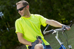 Mountain Biker. Male cyclist preparing to ride a mountain bike in a park Stock Images