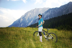 Mountain biker. Relaxing  during a bike ride Stock Photos