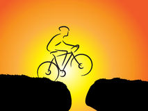 Mountain biker. Jump of mountain biker edge to edge at sunset. Success Stock Images