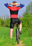 Mountain biker. In spring landscape Stock Photos