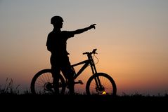 Mountain biker. Silhouette in sunrise Stock Images