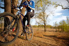 Mountain biker. A mountain biker riding through a trail Stock Photography