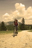 Mountain biker. Girl riding her mountain bike stock photography