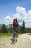 Mountain biker. Girl riding her mountain bike royalty free stock image