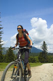 Mountain biker. Girl riding her mountain bike royalty free stock photo